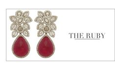 These dazzling ruby earrings are designed by Anmol Jewellers