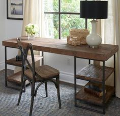 Morella Desk. Heavy wooden planks beautifully finished and held up by iron supports. $1,299