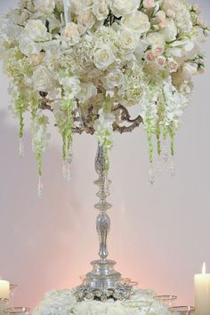 tall white floral centerpiece - candlesticks (flowers would be slightly different, but height vs width is the same)