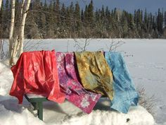 """Snow Dyeing, from Tamarack Shack. """"The basic science to this is the cold temperture provided by the snow cause the dye molecules to slow down their ability to attach to the fabric giving the dye time to separate into their original colors if your using a mixed dye, not a pure dye.  Some colors will move a bit faster and attach to the fabric first creating the really cool patterns on the fabric."""""""