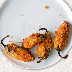 Jalapeño Poppers From O, The Oprah Magazine Spicy jalapeños are stuffed with cheese, then rolled in cornmeal and deep-fried to make these addictive snacks. Jalapeno Popper Recipes, Jalapeno Poppers, Appetizer Recipes, Appetizers, Dessert Recipes, Snack Recipes, Gastro Pubs, Pub Food, Cooking Recipes