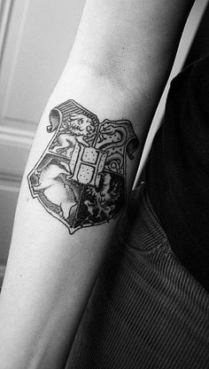 I've always wanted a grayscale Hogwarts Crest tattoo...but seriously, I do.