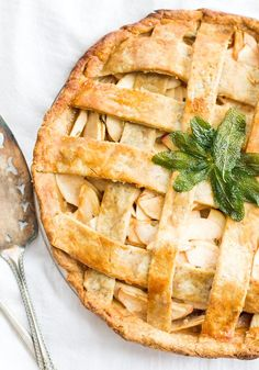 our favorite recipe for gluten-free apple pie with lattice top, apples piled a mile high with a flaky crust.