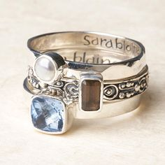 Love this set of three sterling silver Bali Scroll Rings. Hammered band with pearl; scrollwork band with smoky quartz; smooth band with blue quartz. Gorgeous.