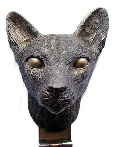 *door knocker cat head, with glowing big magical eyes, brass bastette, Bast cat!