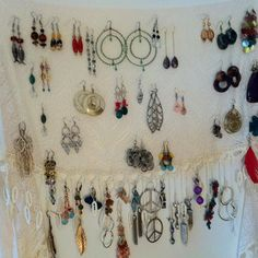 Hung a lace scarf on the back of my closet door to organize earrings! Time saver in the mornings so I don't dig around for earrings!