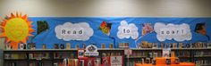 Read to soar! with dollar store kites, clouds with gray swirls, and a happy sunshine!