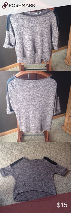 Pink & black knit shirt w/ black shoulders. Light pink and black knit shirt which looks good with tank underneath. Front is slightly shorter than the back as designed. Silky-capped black shoulders. Size large, but fits like a medium. Wall Flower Tops Tees - Short Sleeve