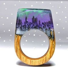 The Aurora borealis wooden ring, inspired from the natural solar phenomenon that takes place at the arctic circle ✨ Only @sxwoodencreations wooden rings with artful landscapes and realistic environments!!! #sxwoodencreations #woodenrings #awsomering #handmadejewelry #handcrafted #rings #secretwood #miniature #world's #resinrings #auroraborealis #arctic #circle #solar #phenomenon #space #universe