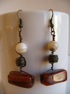 Hey, I found this really awesome Etsy listing at https://www.etsy.com/listing/168163267/dangle-earrings-with-polished-stone