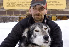The two-time defending Iditarod Trail Sled Dog Race champion Lance Mackey sits with his lead dog Larry at the Iditarod headquarters in Wasilla, Alaska, Wednesday, March 4, 2009. Mackey, who the won Iditarod and Yukon Quest International Sled Dog Race twice in a row in 2007 and 2008, is the only musher to win both of the long distance sled dog races in the same year. (AP Photo/Al Grillo)
