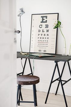 Home office with a simple black desk, eclectic art, and a IKEA stool as a chair Desk Inspiration, Interior Design Inspiration, Design Ideas, New Living Room, Home And Living, Office Decor, Home Office, Office Ideas, Ikea Stool