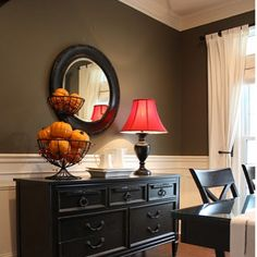 Love the paint color on the wall with black furniture!