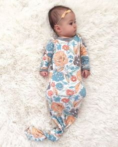 coral and blue floral knotted gown newborn coming home outfit Baby girl or boy clothes can be functional and cute! These newborn knotted gowns are a mom must have! YOu can stress about baby names but not what they are going to wear! Baby clothes that are