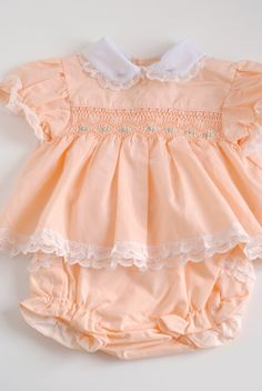 Sweet vintage baby dress in peach.