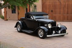 This hot rod convertible with a back seat would be the perfect car for me.