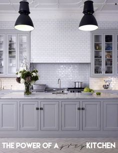 The color grey is pretty fascinating. It has quickly become the modern neutral of our times. More often than not, grey is used in the homes of young professional couples and hip families. Some of the most glamorous rooms are layered in greys. I totally love this. One of my clients right now is selecting finishes for their kitchen and we are drawn towards going grey. They have small children and want a kitchen area that is family friendly and easy to clean. Grey is a perfect color to hid...
