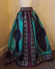 Lovely African print full length cotton Dashiki Maxi skirt, High waist and elasticized waist on back, gathering all around. Un-Lined (Lining on