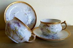 A Simply Stunning Pair of Antique French A.H.& Co.Porcelaine Cabinet Cups and Saucers ensemble with Superb Swirled Shape and Gilt Detailing making a Wonderful Addition for any Collection.  Discovered in the Heart of Rural Normandie in Northern France at a Recent Village Brocante,this gorgeous little set was balanced precariously at the edge of a Table! Its wonderfully decorated design including stippled burnished Gold Rims and Solid Gold painted Handles was glinting in the early mmorning ...