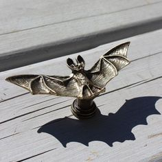 Bat drawer knobs / furniture knobs $7.50 Bats, the underrated guardians of the night, symbolize death and rebirth. These are the only mammals capable of flying and use incredible echolocation techniques to catch insects mid-air. They are often spotted overhead on warm summer nights in wooded areas. Bring these amazing creatures into your home with our charming metal bat-shaped drawer knobs! These fun drawer pulls are perfect for bat lovers, or anyone who appreciates the delightfully spooky!