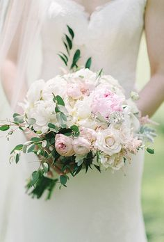 Spring weddings call for a romantic bouquet, and this pale pink option created by Toulies en Fleur, a florist based in Washington, DC, does not disappoint. Here, they paired peonies with roses and ranunculus.