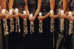 Bridesmaids carrying candles instead of flowers! Love this idea...