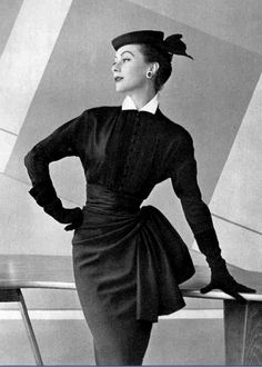 1953 Gigi in navy wool skirt draped and caught at the hip, worn with silk surah blouse with small white collar by Pierre Balmain, photo by Pottier,