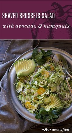 Shaved Brussels Salad with Avocado, Kumquats & Anchovy Dressing from http://meatified.com | This shaved brussels salad is like slaw, only better! It's crunchy, vibrant & a great way to get some extra greens, tossed with a punchy, zingy dressing.