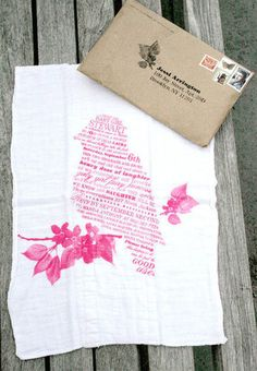 """Yep, this beautiful bird invitation is actually printed on a cloth diaper. According to the designers at Workshop: """"This mother is planning to use cloth diapers for her baby, so we chose to silk-screen event information onto a cloth diaper that could be passed to the mother at the shower and later 'put to good use,' as the copy reads. The envelopes are 100 percent recycled shopping bags."""""""