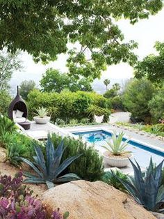 """""""This San Diego, California swimming pool is surrounded by lush plants, lounge chairs, and reading nooks, perfect for a summer's day. The landscaping is also designed to resist wildfires, a danger in California's hot, dry climate. """" from myhomeideas.com"""