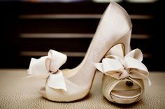 white satin heels open toe, with a gorgeous bow. My feet will sure hate me, but i'll look ah-mazing