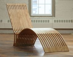 A symphony of free-flowing curves define a lounge chair by Tommy MacDonald.