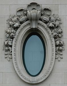 Beaux-Arts window on the facade of a building on Michigan Avenue at Adams Street in Chicago, Illinois.