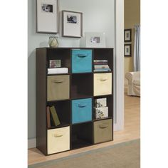 """Threshold's 9 cube organizer has 9 convenient cube openings for storage and is compatible with 13"""" storage bins and Threshold cube accessories. This item features a finished front and back to allow for storage access from both sides and has a thick exterior frame. Can be displayed horizontally or vertically. Perfect for organizing any room in the house. This Threshold  9 cube organizer comes with all hardware included. To clean, wipe with a dry cloth.<br><br>Weight ..."""