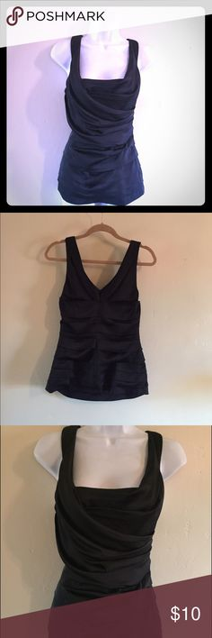 Dressy Top NEW 🇺🇸 Sexy black top from Express with figure flattering detail (too big on me otherwise I would keep this beauty). Only worn to try on. Bundle and Save 💰 Express Tops