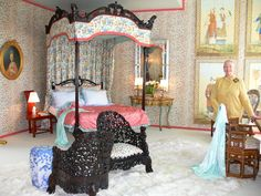 """Tonin McCallum used a creative furniture layout and hand-blocked, leopard fabric on the walls to cover the structural issues in her light-filled room called """"A Sunny Boudoir."""""""