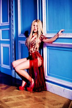 Shakira, if I was wearing those heels I would be holding onto the wall for dear life too!