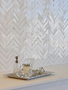 Raj, a natural stone mosaic shown in Thassos and polished Calacatta Tia, is part of the Silk Road Collection