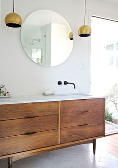 When designing your own bathroom, pair old with new or budget-friendly with high-end. It brings personality and character to a space.