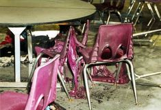 Columbine  Melted plastic chairs in the Columbine Highschool cafeteria after the massacre. One of the shooters, Dylan Klebold, had thrown a molotov cocktail in an attempt to set off one of the larger propane bombs, resulting in a small area of fire damage.
