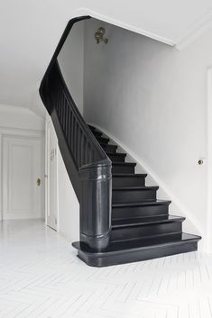 The staircase painted black/blue for a softer feeling.