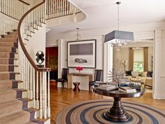 Transitional Entry by S. B. Long Interiors - White wood paneling is well proportioned for the ceiling height.