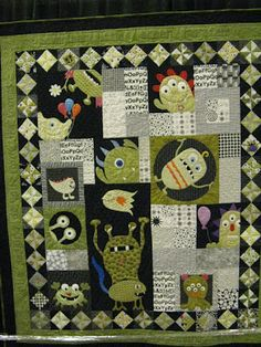 "Love the monster in the circle, tilting sideways. Ann L. Peterson's award winning quilt ""Peek A Boo Monsters"""