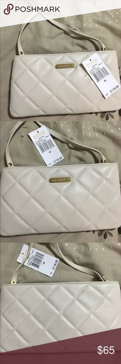 Michael Kors quilted. Michael Kors quilted bag. Can be used as a shoulder bag or clutch. Color Vanilla smooth leather. Almost new has a little transfer color on the back but you can barely see. Michael Kors Bags Shoulder Bags