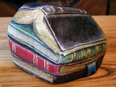 Painted ROCK into Books! What a great idea for a door stop, book end or garden decoration!