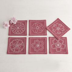 Sashiko coasters. An unusual fabric colour for sashiko, but works well with the…