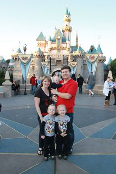 A family that usually visits Walt Disney World stand in front of Sleeping Beauty Castle in Disneyland on their first visit