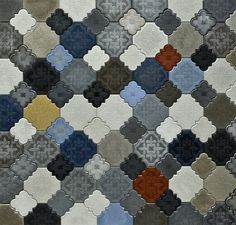 Flaster Concrete Tiles by Ivanka Studio  Designed by Budapest's Ivanka Studio, the ornate Flaster concrete tiles allow you to create your very own floor and wall surfaces by mixing and matching tiles of different colors.  site: Ivanka Studio