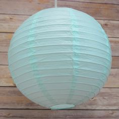 16 Inch Artic Spa Blue Hanging Round Paper Lanterns on Sale Now! We offer vintage and unique Wedding Decorations, party supplies, decor, and lighting supplies in Bulk at Wholesale Prices. White Paper Lanterns, Chinese Paper Lanterns, Patio String Lights, Globe String Lights, Indian Wedding Theme, Lamp Cord, Led Light Kits, Lantern Lamp, Party Lights