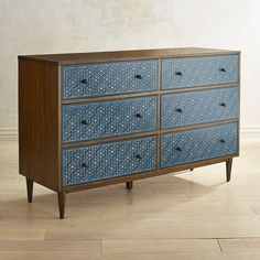Mid-century design meets Old World artistry in our Oliver Collection. It features a blue silk-screen atop a walnut brown finish, plus round tapered legs handsomely accented with metal caps.